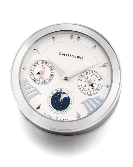 An attractive silver-plated brass and wood embossed full calendar table clock with moon phases and leap year indication