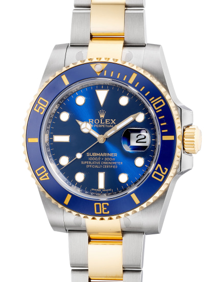 A fine and well-preserved two tone yellow gold and stainless steel diver's wristwatch with date, center seconds, bracelet, guarantee and box