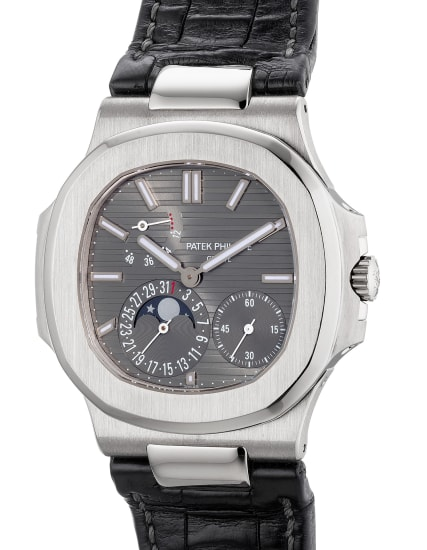 A fine and rare white gold wristwatch with small seconds, date, moon phases, power reserve indication, Certificate of Origin and presentation box