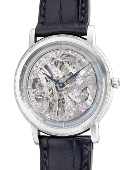 An extremely fine and rare limited edition platinum and mother of pearl skeletonized wristwatch with mother of pearl cherry blossoms, hand engraved bridges, guarantee, tapestry, fitted presentation box and outer packaging, numbered 30 of a limited edition of 40 pieces