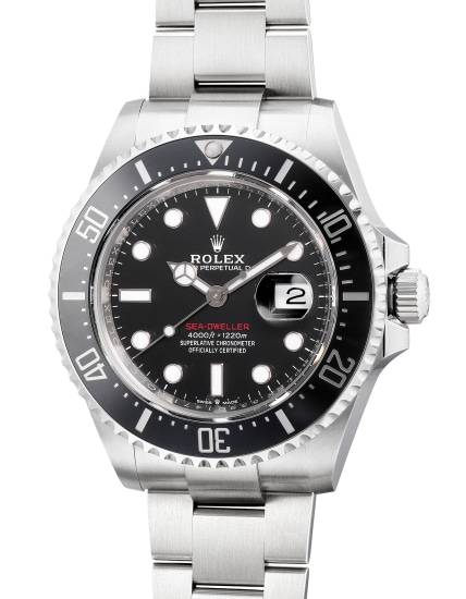A fine, attractive and well-preserved stainless steel diver's wristwatch with date, center seconds, helium escape valve, bracelet, guarantee and box