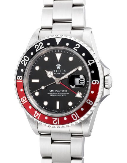 A fine, attractive and well-preserved stainless steel dual time wristwatch with center seconds, date, bracelet, guarantee and box