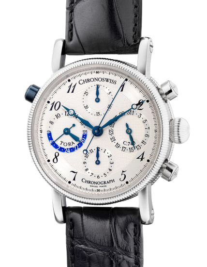A fine platinum chronograph wristwatch with date, day and night indication, guarantee and presentation box