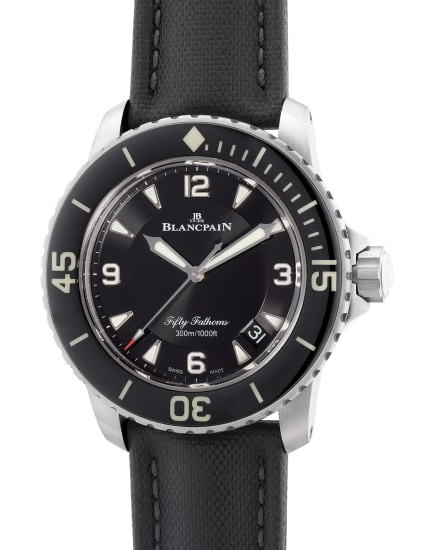 An attractive and well-preserved titanium diver's wristwatch with center seconds, date, warranty and box