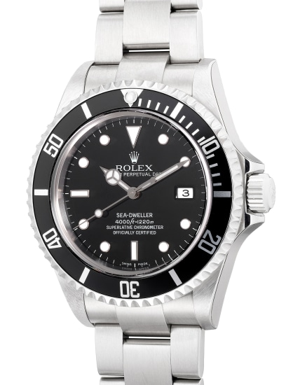 """A fine and attractive, """"New Old Stock"""" stainless steel diver's wristwatch with center seconds, date, gas escape valve, bracelet, guarantee and box"""