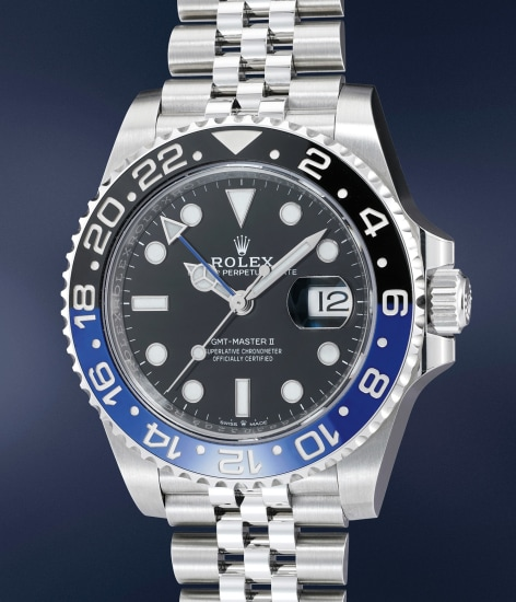 A fine, attractive and well-preserved stainless steel dual time wristwatch with center seconds, date, black and blue Cerachrom bezel, bracelet, guarantee and presentation box