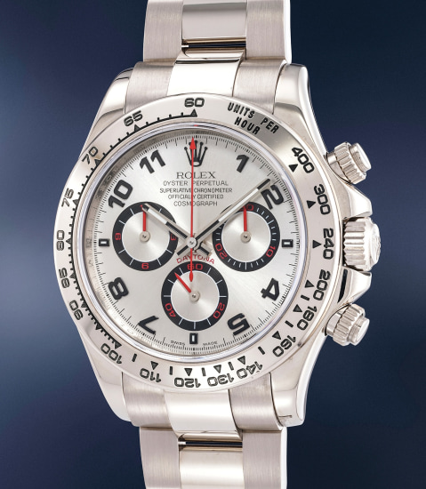A fine and rare white gold automatic chronograph wristwatch with bracelet, Guarantee and box, originally sold to Eric Clapton