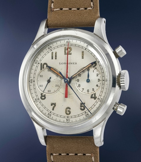 A very rare stainless steel chronograph wristwatch with red central chronograph minute hand