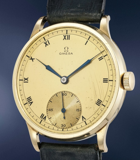 A large and extremely attractive 14K yellow gold wristwatch with two-tone gilt dial