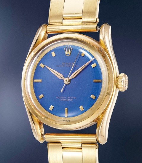 An extremely rare and most attractive yellow gold wristwatch with bombé lugs, blue enamel dial and bracelet