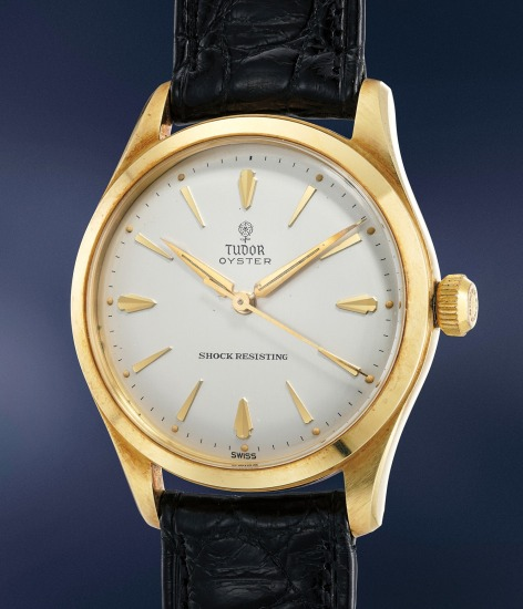 An elegant and very well-preserved yellow gold automatic wristwatch with center seconds