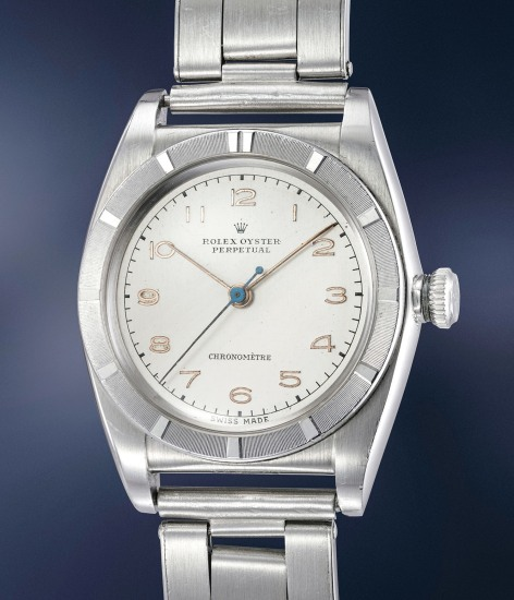 A highly rare, very attractive and extremely well-preserved stainless steel wristwatch with center seconds and bracelet