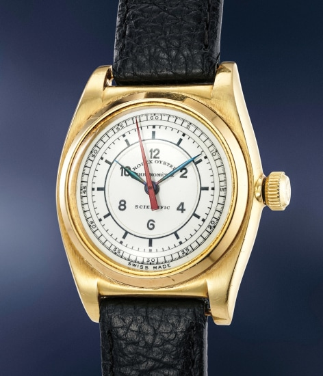 An extremely rare and elegant yellow gold wristwatch with red center seconds and enamel sector dial