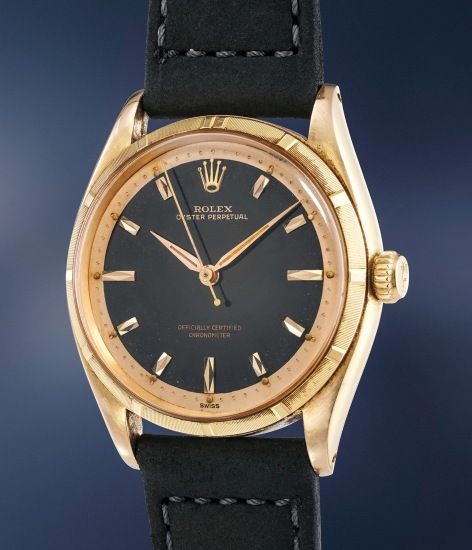 A highly rare and attractive pink gold wristwatch with black lacquer dial and guarantee