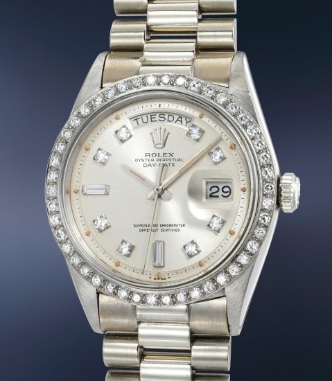 A rare and attractive white gold and diamond-set calendar wristwatch with bracelet