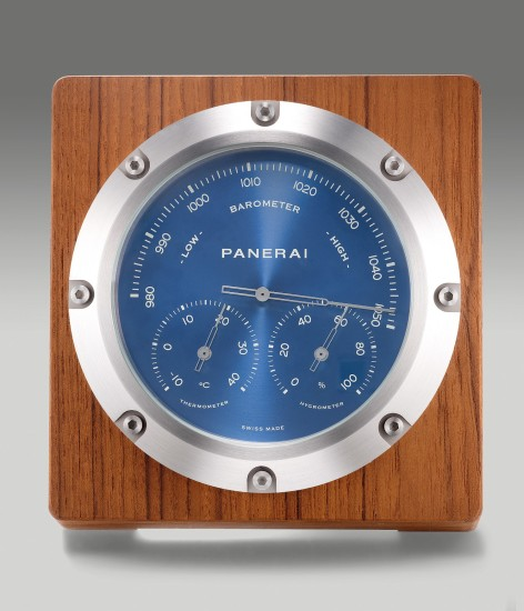 A fine limited edition brushed stainless steel and teak wood desk top instrument with barometer, hygrometer and thermometer
