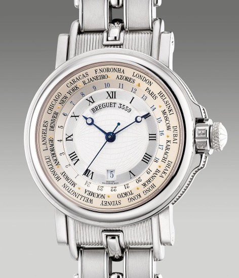 An attractive and heavy white gold world time wristwatch with center seconds, date and bracelet
