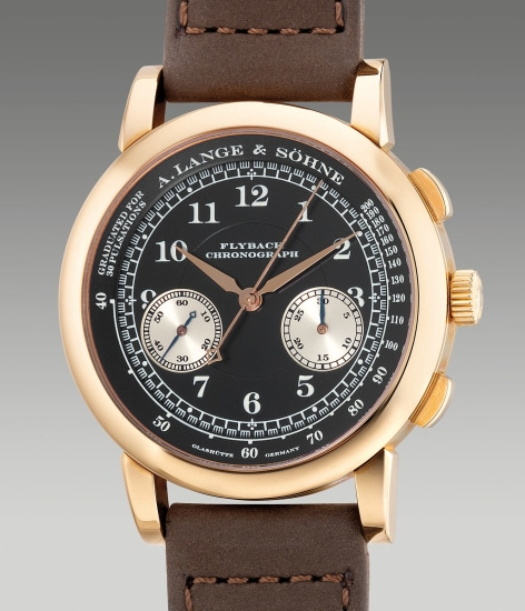 A rare and attractive pink gold flyback chronograph wristwatch with black dial, guarantee and presentation box