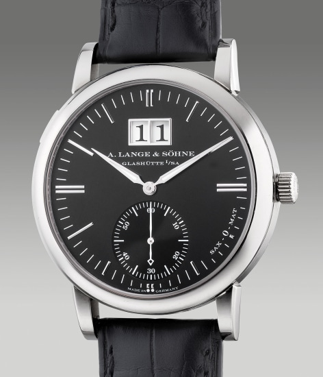 A fine and attractive white gold wristwatch with small seconds, oversized date display, guarantee and box