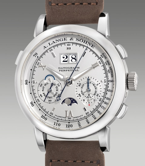 A fine and attractive platinum perpetual calendar flyback chronograph wristwatch with large date, moon phases, leap year indication, day and night indication, guarantee and box