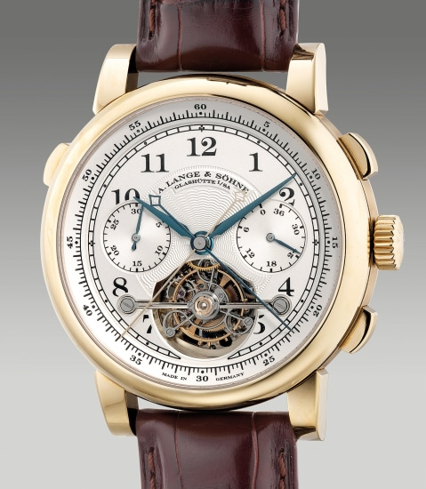 A very fine, rare and important limited edition honey gold tourbillon double split seconds chronograph wristwatch with power reserve indication, fusée-and-chain transmission, guarantee and box, numbered 3 of a limited edition of 50 pieces