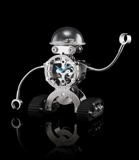 A rare, fine and whimsical limited edition palladium-plated, diamond-set and rubber robot-form desk clock with 8-day power reserve and guarantee