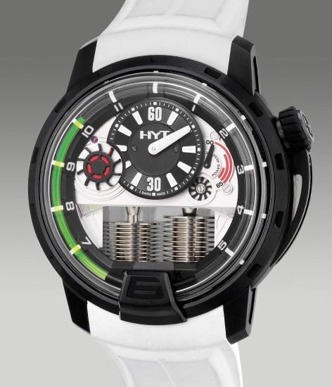 A fine and unusual DLC-coated titanium semi-skeletonized wristwatch with small seconds, retrograde fluid hours, power reserve indication, warranty and box