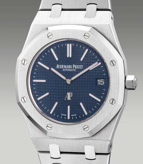 A fine and attractive stainless steel wristwatch with date, bracelet, warranty and box