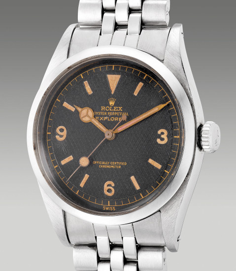 A very rare, fine and attractive stainless steel wristwatch with center seconds, 'Explorer' honeycomb dial and bracelet