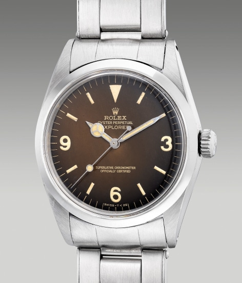 "A very fine and rare stainless steel wristwatch with center seconds, black lacquer ""tropical"" dial and bracelet"