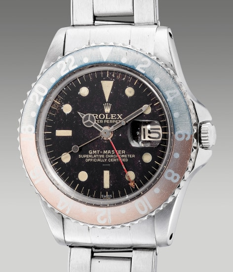 """A very rare, attractive and fine stainless steel dual-time wristwatch with center seconds, date, """"tropical"""" gilt underline double """"Swiss"""" dial, pointed crown guards, bracelet, guarantee and box"""
