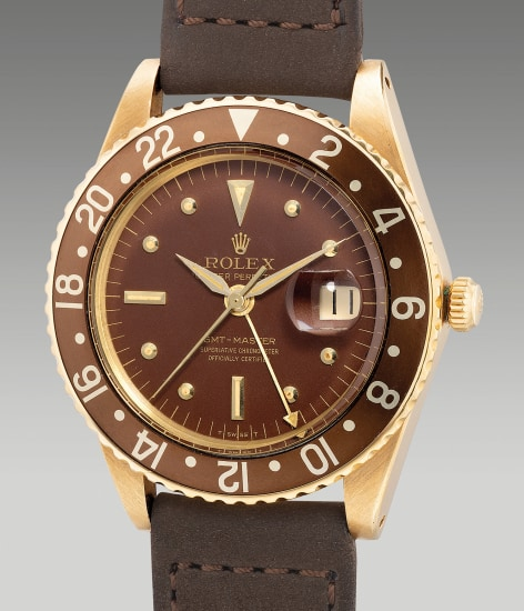 A very fine, early and rare yellow gold dual-time wristwatch with center seconds, date and no crown guards