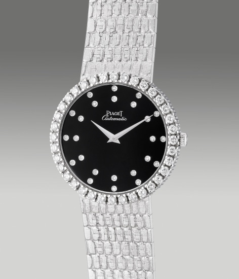 A fine and attractive white gold and diamond-set wristwatch with diamond-set dial and integrated bracelet