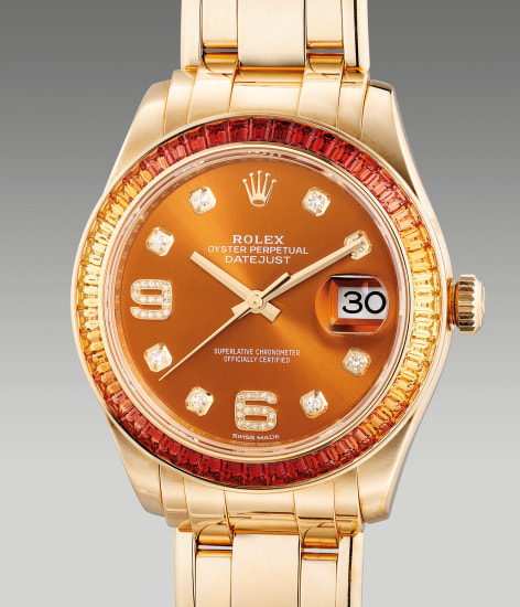 A fine and attractive yellow gold wristwatch with center seconds, date, multi-colored sapphire-set bezel, diamond-set indexes and bracelet