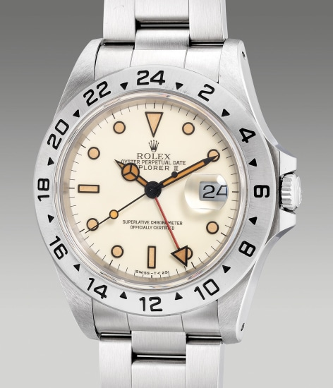 An attractive and rare stainless steel wristwatch with 'ivory' dial, 24-hours indicator, center seconds, date, bracelet, guarantee and presentation box