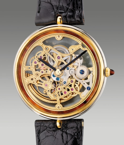 A fine two-tone yellow gold and white gold skeletonized wristwatch with tortoise shell outer minute track inlay