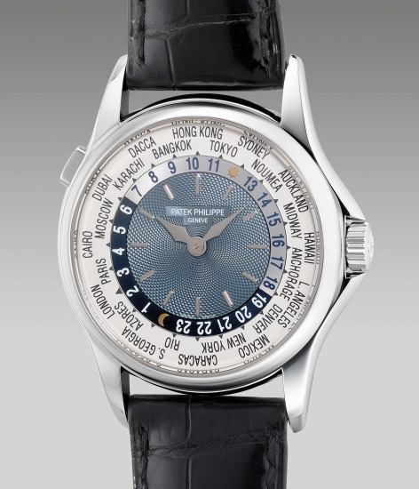 "A fine and attractive platinum world time wristwatch with ""guilloche"" dial and presentation box"