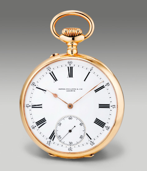 A fine yellow gold open face pocket watch with small seconds and enamel dial