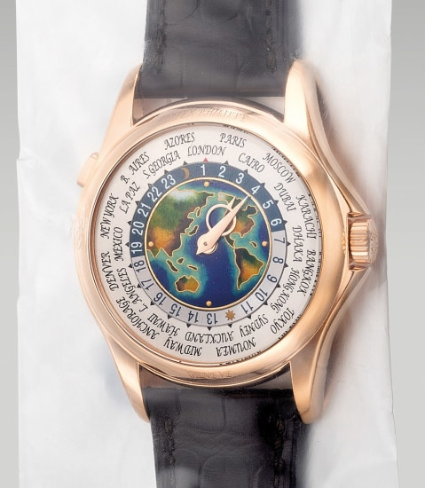 A very fine and rare pink gold world time wristwatch with cloisonné enamel dial, with Certificate of Origin and presentation box, single sealed