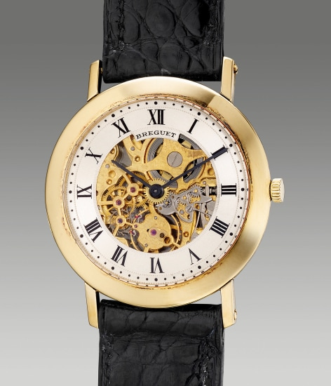 An attractive and thin yellow gold skeletonized wristwatch