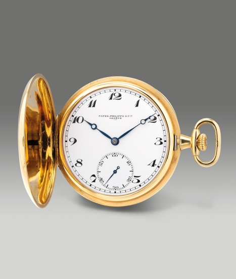 A fine yellow gold hunter case pocket watch with small seconds, enamel dial and Breguet numerals