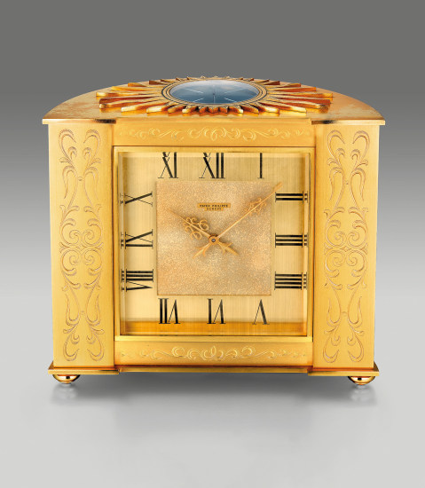 An attractive and well preserved gilt brass engraved solar Pendulette Demi-Lune table clock