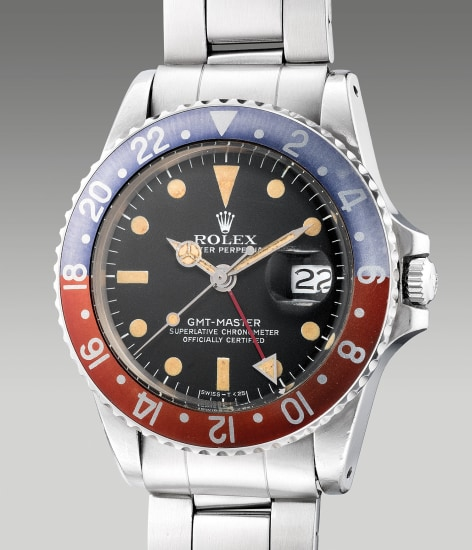A fine and attractive stainless steel dual-time wristwatch with center seconds, date and bracelet