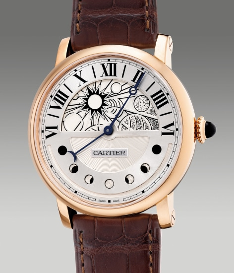 A fine and large pink gold wristwatch with retrograde hours and moon phases