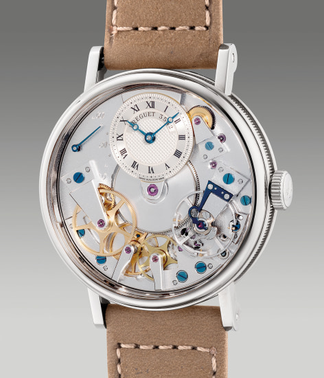 A fine and attractive white gold semi-skeletonized wristwatch with power reserve indication and box