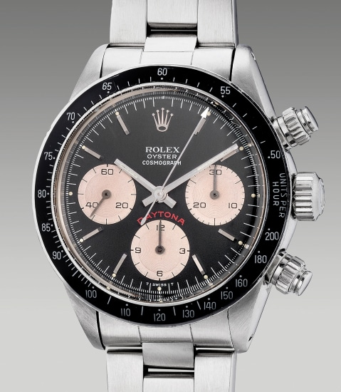 A very rare and attractive stainless steel chronograph wristwatch with black dial, bracelet, warranty and presentation box