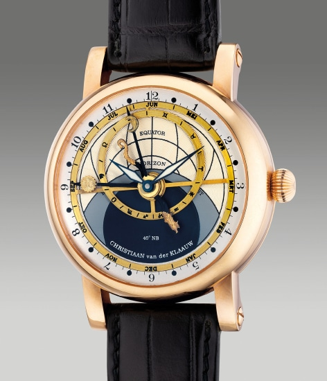 A very fine and unusual pink gold astronomical wristwatch with month, zodiacs, solar and lunar positions, warranty and box