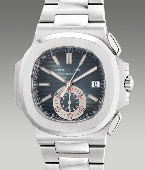 A fine, well-preserved and rare stainless steel flyback chronograph wristwatch with date, bracelet, Certificate of Origin and presentation box