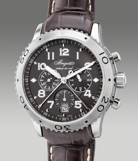 A fine, unusual and large stainless steel pilot's flyback chronograph wristwatch with date