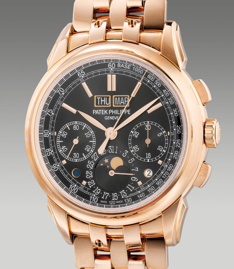 A very fine and attractive pink gold perpetual calendar chronograph wristwatch with moon phases, day and night indication, leap year indication and bracelet